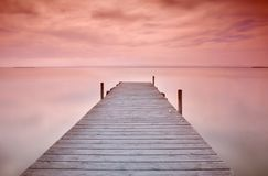 Wooden pier at sunset Royalty Free Stock Photos