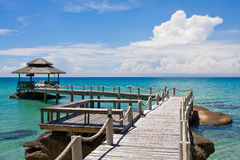 Wooden pier, Thailand. Beautiful tropical beach in Koh Kood , Thailand Royalty Free Stock Photo