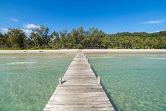 Wooden pier to a tropical island beach on Koh Kood island during day time. Thailand Stock Photo