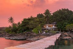 Wooden pier to a tropical island resort on Koh Kood island during sunset. Thailand Royalty Free Stock Photo