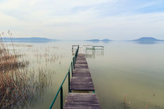 Wooden pier in tranquil lake Balaton Stock Images