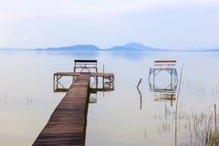 Wooden pier in tranquil lake Balaton Stock Image