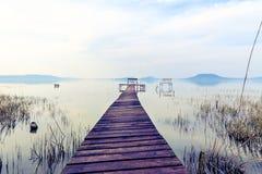 Wooden pier in tranquil lake Balaton Royalty Free Stock Photos