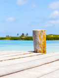 Wooden pier on tropical island Stock Images