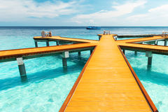 Wooden pier at tropical island resort Stock Photography