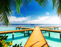 Wooden pier at tropical island resort Royalty Free Stock Photos