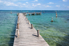 Wooden pier on the turquoise sea Royalty Free Stock Photography