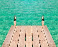 Wooden pier in turquoise sea Stock Images