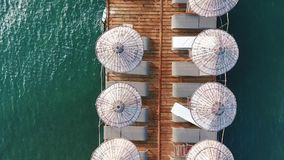 Pier. Wooden pier and turquoise water from above - shot from a drone stock video