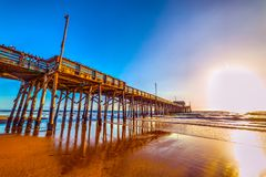 Wooden pier under a clear sky in Newport Beach. California, USA Royalty Free Stock Photo