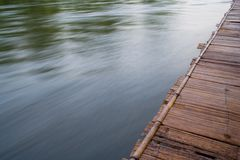 Wooden pier and water. Wooden pier over flowing water with motion blur effect Stock Images