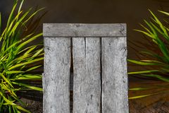 A wooden pier and water. top view royalty free stock image