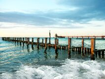 Wooden pier in waves Royalty Free Stock Photo