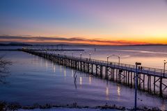 White Rock pier during a sunset in winter. BC, Canada stock photo