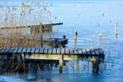 Wooden pier in winter Stock Photos