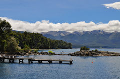 Wooden pier in Wooden pier in Los Arrayanes National Park.San Ca Stock Photo