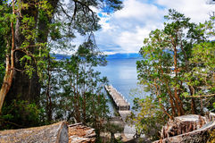 Wooden pier in Wooden pier in Los Arrayanes National Park. Stock Images