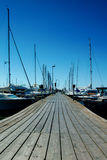 Wooden pier and yachts Stock Photos