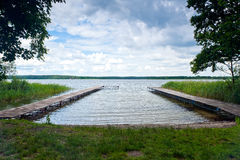 Wooden piers int Dominicke Lake, Boskowo City, Poland Stock Photography