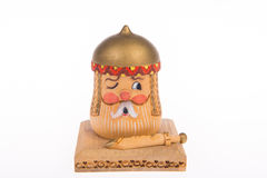 Wooden piggy bank in the form of a knight for coin storage Stock Image