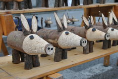 Wooden pigs. Cute Wooden pigs on a counter street market Royalty Free Stock Photo