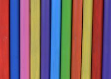 Wooden piles in rainbow colour Royalty Free Stock Photo