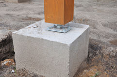 Wooden pillar on the construction site with screw Stock Photos