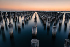 Wooden Pillars on Body of Water Stock Images