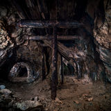 Wooden pillars in the old mine, catacombs Royalty Free Stock Image