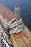 Wooden pin on the side of the ship. Rigging on a side of The deck of The Tall Ship in Glasgow with the water in the backgroung Royalty Free Stock Photos