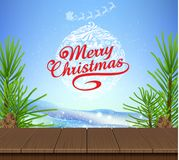 Wooden and pine tree christmas blue sky background.  Royalty Free Stock Photo