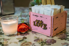 Wooden pink box with white stickers Royalty Free Stock Photo