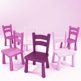 Wooden Pink Chairs. Group of jumbled pink chairs in various tones Royalty Free Stock Photos