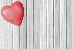Wooden pink heart on white wooden texture close-up Royalty Free Stock Photography