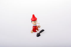 Wooden pinocchio doll with his long nose Stock Image