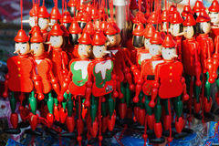 Wooden pinocchio dolls with his long nose Royalty Free Stock Photos