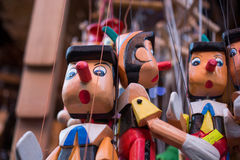 Wooden pinocchio dolls with his long nose Stock Images