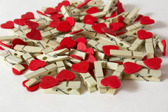 Wooden pins. With red hearts on the white background Stock Photo