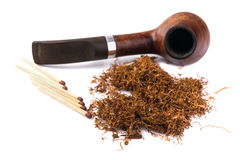 Wooden   pipe with dried tobacco leaves Stock Photography