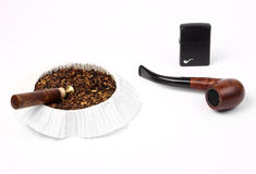 Wooden pipe with tabacco and lighter Royalty Free Stock Photography