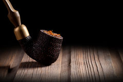 Wooden Pipe and Tobacco Stock Images