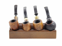 Wooden pipes on an holder Stock Photo