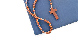 Wooden plain rosary on Bible. Royalty Free Stock Images