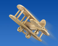 Wooden plane in the blue sky Royalty Free Stock Photography