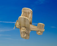 Wooden plane on a blue sky Stock Image