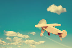 Wooden plane flying in the sky. Royalty Free Stock Photos