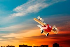 Wooden plane flying in sunset stock photos