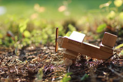 Wooden plane on the ground outdoor Royalty Free Stock Photo