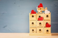 Wooden plane with heart and chest with drawers. On the table Royalty Free Stock Photos