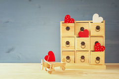 Wooden plane with heart and chest with drawers. On the table Royalty Free Stock Photo